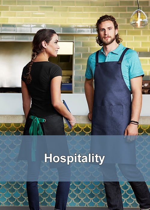 Employees in the hospitality industry wearing denim aprons while working